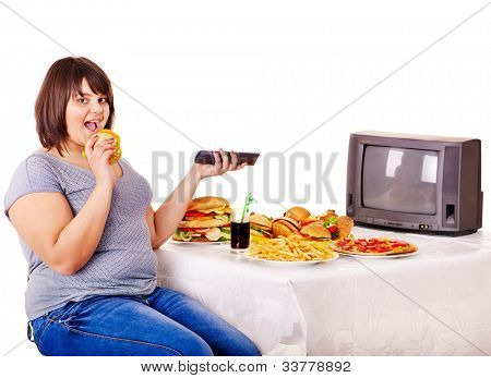 Overweight woman eating fast food and watching TV. Isolated.