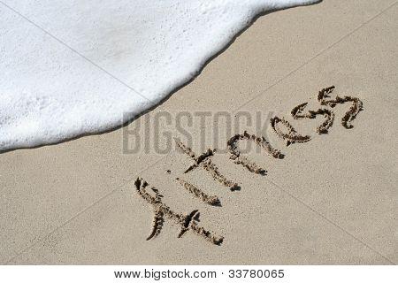 Fitness hand written in the sandy beach