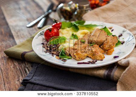 potato puree, pork cuff filet and cepes sauce