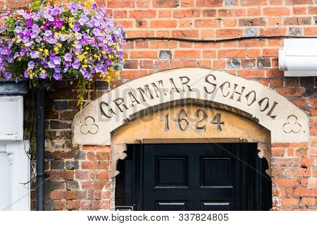 Lintel Above The Entrance To The Old Grammar School Dated 1624 And Hanging Basket.