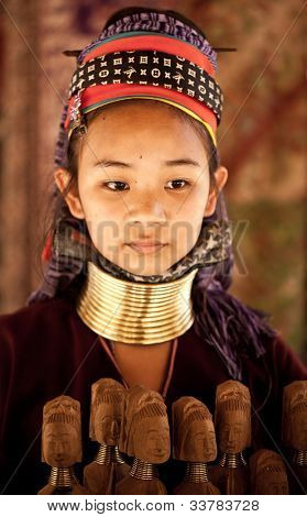 NAI SOI, THAILAND - FEB 3: Unidentified Karen long neck young woman in the village, review of daily life of local people, Padaung tribe near to Myanmar border on Feb 3, 2012 in Nai Soi, Thailand.