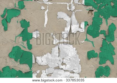 Nigeria flag depicted in paint colors on old obsolete messy concrete wall closeup. Textured banner on rough background poster