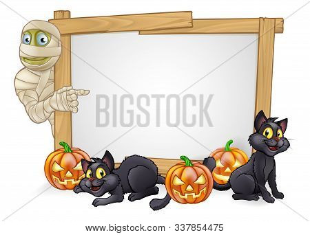 A Cartoon Halloween Mummy Character Pointing At A Sign With Black Witches Cats And Carved Pumpkins
