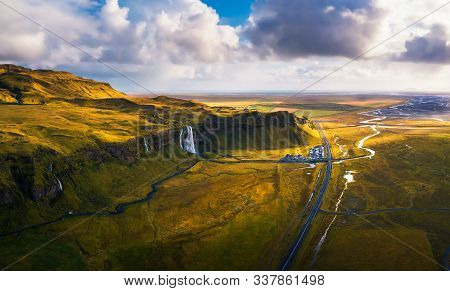 Aerial View Of Seljalandsfoss Waterfall, Seljalands River, Waterfall Parking And The Ring Road In Ic