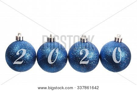 Four Blue Spangled Christmas Balls Arranged In The Year 2020