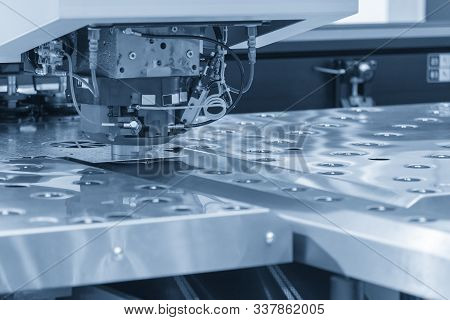 The Hi-speed Turret Punching Machine For Sheet Metal Piercing Process Control By Cnc Program. The Mo