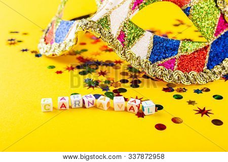 Festive Yellow Background With Colorful Carnival Mask Cubes With Dutch Text Carnaval. Greeting Card