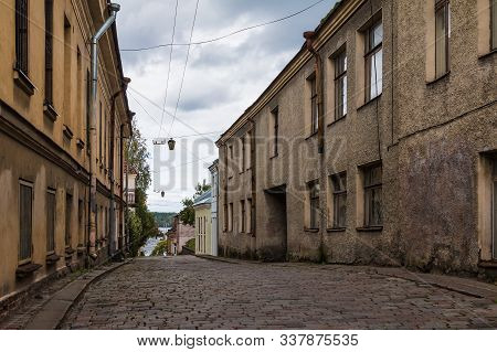Perspective View Of The Apartment Buildings On The Water Outpost Street In Overcast Day, Vyborg, Len