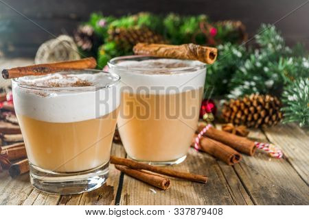 Autumn Winter Hot Toddy Alcohol Cocktail With Spices, Wooden Background With Christmas Decorations.