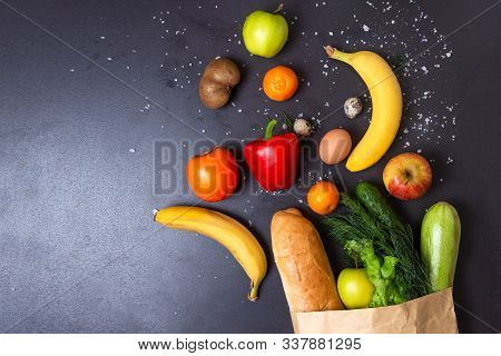 Grocery Vegetables And Fruits Falling From Paper Package. Products From Grocery Store. Groceries