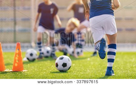 Soccer Training Practice. Player Running With Football Ball In Sports Grass Cleats. Training Session