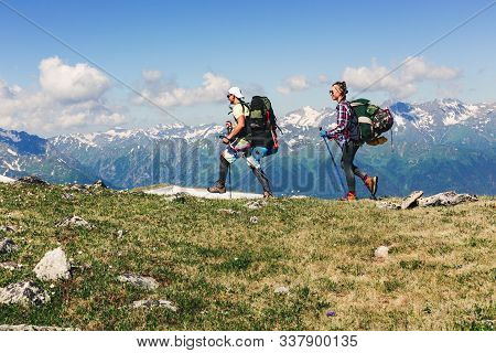 Hikers With Backpacks Hiking In The Rocky Mountains Alone Outdoor Active Lifestyle Travel Adventure