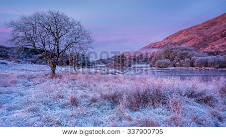 A Cold And Frosty Winter Morning With Mist Drifting On Loch Awe In Scottish Highlands Awaiting For T