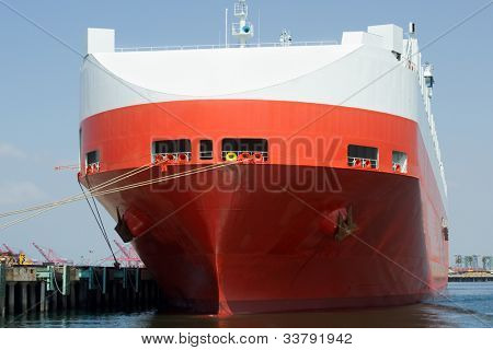 The bow of a large roll-on/roll-off (RORO or ro-ro) car carrier ship docked in a harbor
