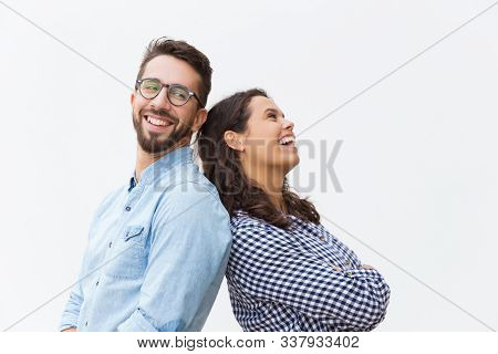 Joyful Carefree Couple Leaning On Each Other, Chatting And Laughing At Joke. Young Woman In Casual A