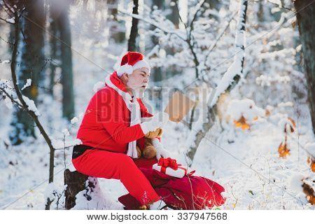Letter To Santa Claus. Dear Santa. Portrait Of Cheerful Dreamy Granny Santa Reading Letter