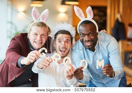 Three friends in funny disguise celebrate the bachelor party in a bar