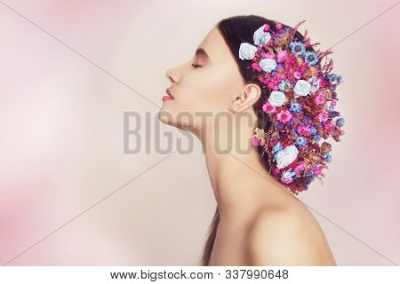 Beautiful Young Woman With Delicate Flowers In Their Hair. Beauty Girl With Flowers Hairstyle.model