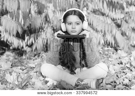 Elearning Today. Little Girl Learning Online Under Tree With Yellow Leaves. Small Child Elearning On