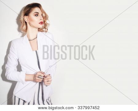 Beautiful Woman Model. Fashion  Young Girl In Overalls Striped . Blond Girl With Cerly Hair And Red