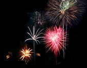 Set of fireworks displaying on black sky background poster