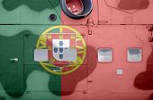 Portugal flag depicted on side part of military armored helicopter closeup. Army forces aircraft conceptual background poster