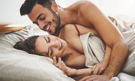 Happy Couple Having Fun On Bed Under Blanket - Young Romantic Lovers Intimate Moments - Intimacy And