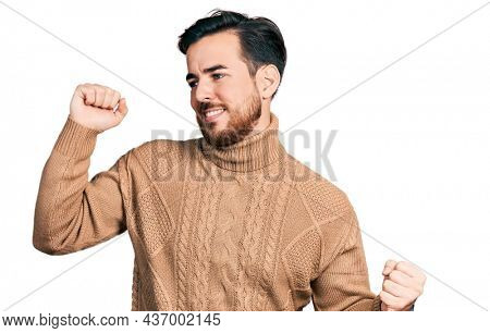 Young hispanic man wearing casual clothes dancing happy and cheerful, smiling moving casual and confident listening to music