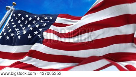 Close Up View Of The American Flag Waving In The Wind. Selective Focus. Democracy, Independence And