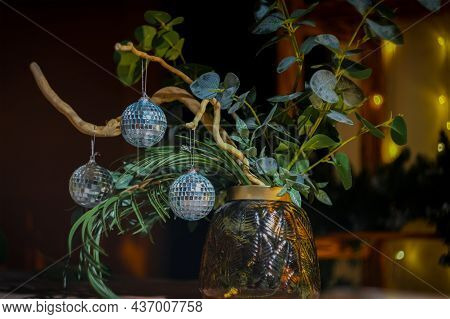 Christmas Flower Arrangement. Various Plants, Tree Branches With Trendy Christmas Mirror Disco Balls