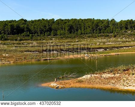a view over the Gaia River at the El Catllar reservoir, in El Catllar, Catalonia, Spain, with a low level of water in autumn
