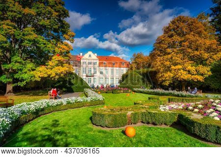 Gdansk, Poland - October 18, 2021: People walking in the autumn park in Gdansk Oliwa, Poland