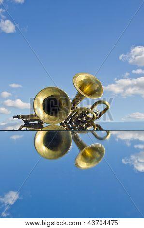 Musical Brass Wind Instruments On Mirror