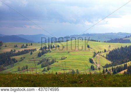 A Green Hill Lit By Soft Sunlight Against The Backdrop Of A Spring Landscape Of The Carpathian Mount