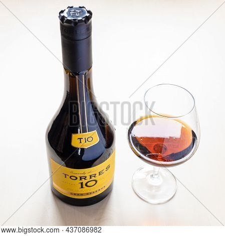 Moscow, Russia - October 16, 2021: Bottle With Torres Gran Reserva 10 Spanish Brandy And Wineglass.