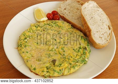 Organic Egg Omelette Stuffed With Cheese, Asparagus, Spinach, Kale Leaves Served With Tomatoes And B