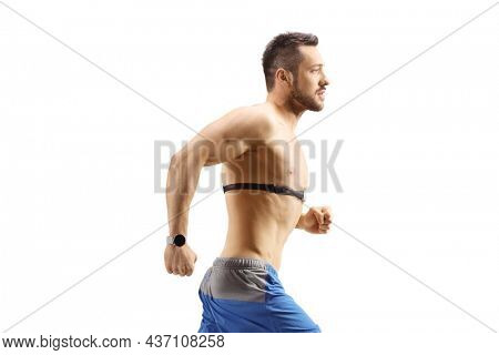 Topless young man running and wearing a chest strap monitor isolated on white background