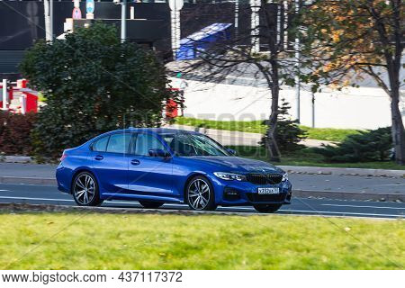 Moscow; Russia - October 13; 2021: Blue Bmw Series 5    Is Driving Fast On The Street On A Warm Autu