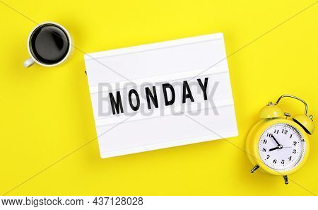 Text Monday On Lightbox With Alarm Clock And Cup Of Coffee For Holiday - Thank God Its Monday. Start