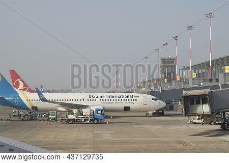 Dalaman, Turkey, August, 2021. Loading Luggage Into A Passenger Airliner At Dalaman Airport.