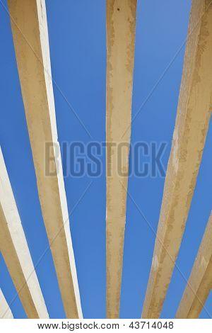Vertical Concrete Shapes On A Rich Blue Sky