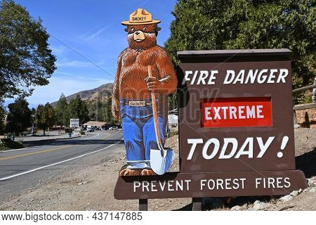 OAK GLEN, CALIFORNIA - 10 OCT 2021: Smokey the Bear Fire Dange sign in the foothills of  San Bernardino Mountains indicating extreme fire danger.