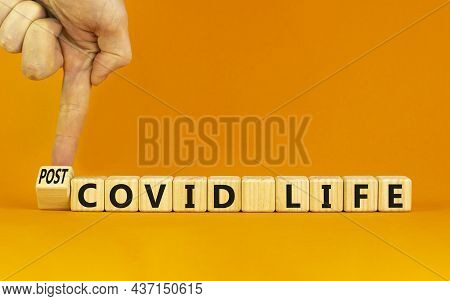 Symbol For A Post-covid Life. Businessman Turns A Cube And Changes Words 'covid Life' To 'post-covid