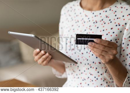 Shopper Using Tablet For Buying On Internet, Paying For Purchase