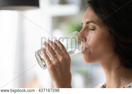Peaceful Woman Satisfying Thirst, Drinking Fresh Pure Clear Cold Water
