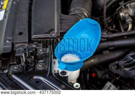 Windshield Washer Fluid Reservoir Cap. Windshield Washer Liquid Cap Inside A Car Engine. Closeup Cap