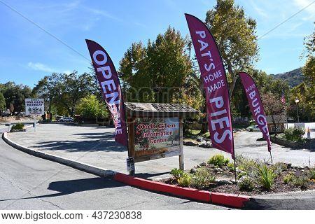 OAK GLEN, CALIFORNIA - 10 OCT 2021: Signs along Oak Glen Road in the San Bernardino Mountains foothills.
