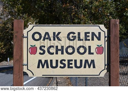 OAK GLEN, CALIFORNIA - 10 OCT 2021: Sign for the Oak Glen School House now a Museum was built in 1927 and is surrounded by a park with picnic tables, tennis court, walking path, and dog park.