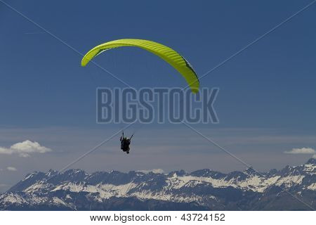 paraglider over the mountains (green)