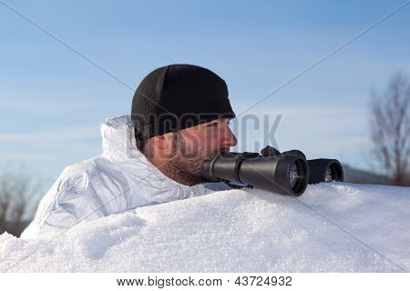 Scout In White Camouflage Coat With Binoculars